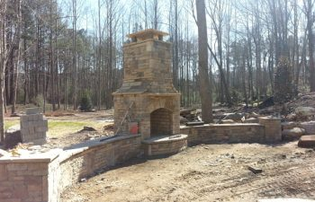 an outdoor stone fireplace