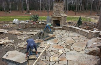Lane Landscaping staff while constructing a flagstone patio