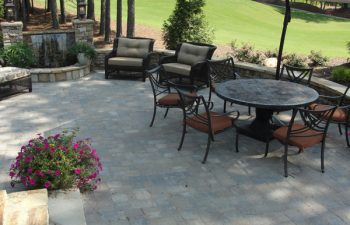 a flagstone patio with outdoor furniture