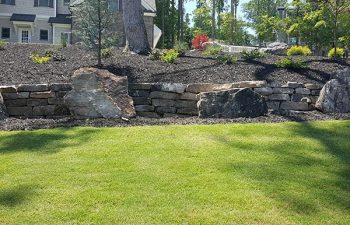 well card lawn with hardscape and retaining walls
