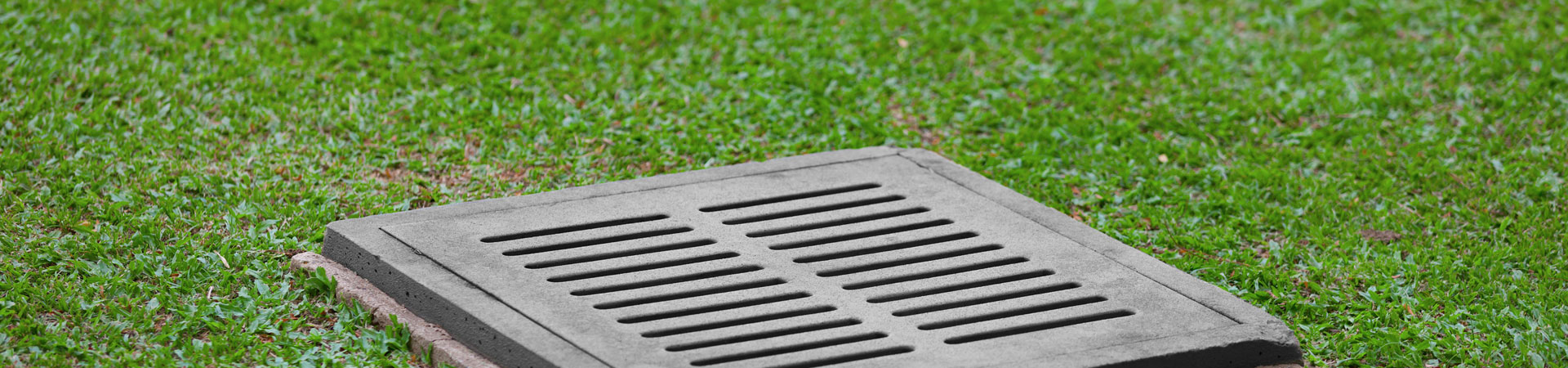 storm drain grate installed as a part of the garden drainage