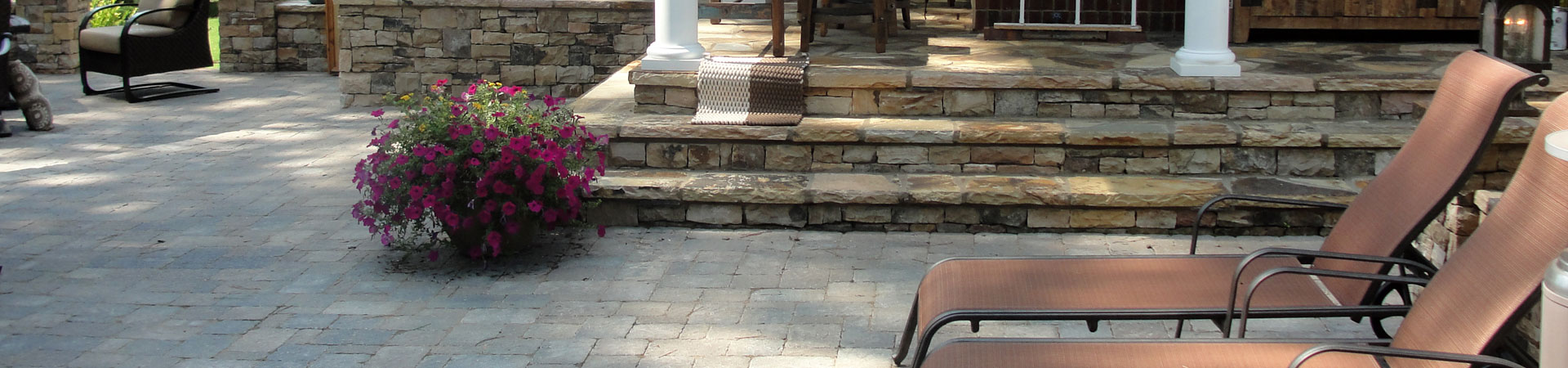 a flagstone porch and paver patio